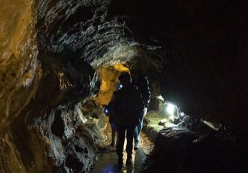 This could be you, exploring the caves with your family